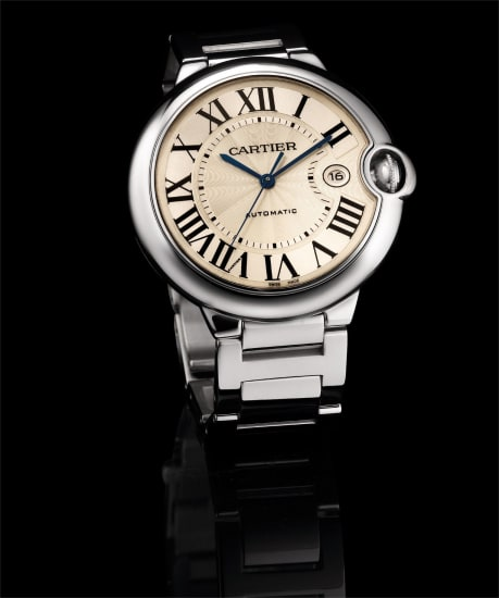 A fine white gold wristwatch with sweep centre seconds, date and bracelet