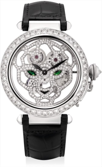 A very fine and rare white gold, diamond, onyx and tsavorite-set skeletonised wristwatch