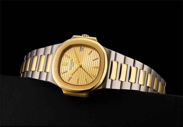 A fine yellow gold and stainless steel wristwatch with sweep centre seconds, date, bracelet and  champagne dial