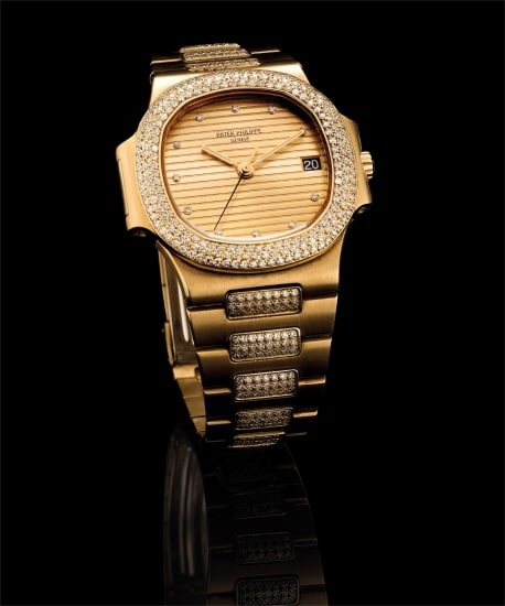 A fine and rare yellow gold and diamond-set bracelet watch with sweep centre seconds, date and champagne dial