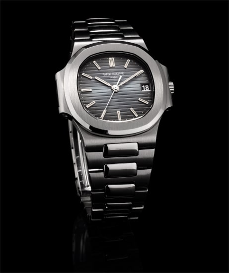 A fine and rare stainless steel bracelet watch with sweep centre seconds and date