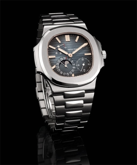 A fine stainless steel wristwatch with date, moon phases, power reserve, bracelet, original certificate and fitted presentation box