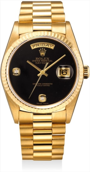 A fine and rare yellow gold and diamond-set calendar wristwatch with onyx dial and bracelet