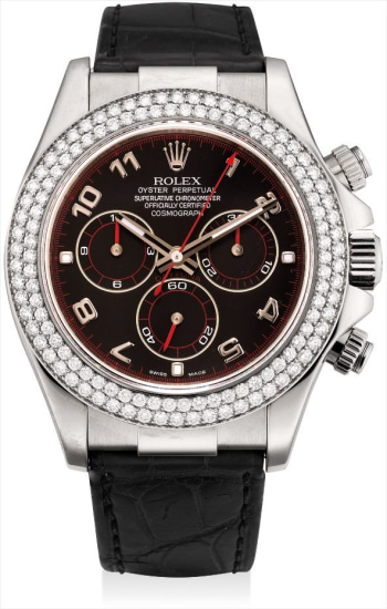 A fine white gold and diamond-set chronograph wristwatch with original guarantee