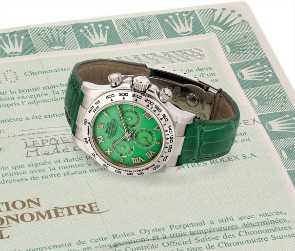 A fine and rare white gold chronograph wristwatch with green chalcedony hardstone dial and original guarantee