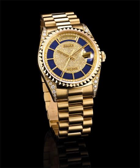 A fine and very rare yellow gold, diamond-set calendar wristwatch with sweep centre seconds, blue enamel and pavé-set diamond dial and bracelet