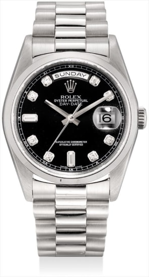 A platinum and diamond-set calendar wristwatch with sweep centre seconds and bracelet