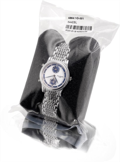 A lady's fine white gold and diamond-set dual time wristwatch with blue enamel dial, 24 hours and bracelet, factory sealed