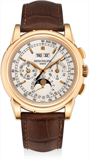 A fine and rare pink gold perpetual calendar chronograph wristwatch with moon phases, 24 hours, leap year indicator, additional case back, original certificate and fitted presentation box