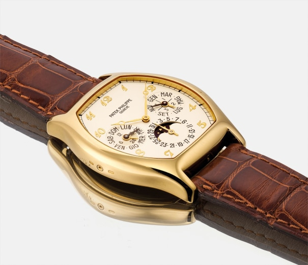 A fine and rare yellow gold tonneau-shaped perpetual calendar wristwatch with moon phases, 24 hours, leap year indicator and Breguet numerals