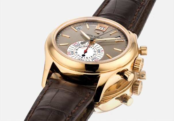 A fine and rare pink gold annual calendar chronograph wristwatch with power reserve and day and night indicator