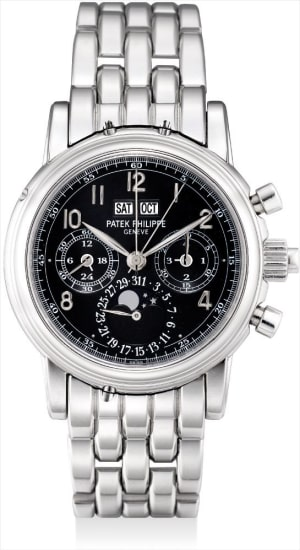 An extremely fine and very rare platinum perpetual calendar split seconds chronograph wristwatch with moon phases, 24 hours, leap year indicator, special black dial, platinum bracelet, original certificate, additional case back and fitted presentation box
