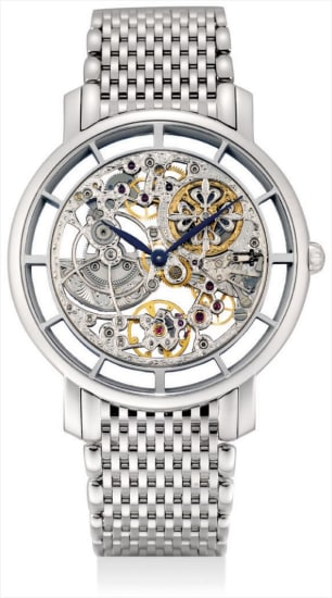 A fine and rare white gold skeletonised bracelet watch with original certificate and fitted presentation box