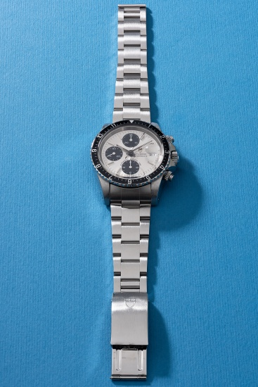 A rare and fine stainless steel chronograph wristwatch with date, bracelet, guarantee and box