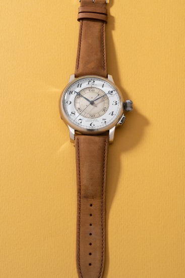 A fine, rare and large stainless steel pilot's wristwatch with center seconds and enamel dial, retailed by Wittanuer