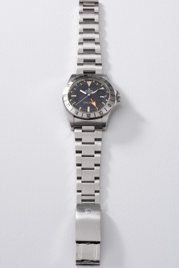 A well-preserved and rare stainless steel wristwatch with 24-hour indication, date, bracelet, guarantee, box and hang tags