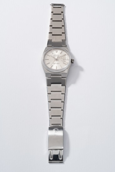 A rare and attractive stainless steel quartz wristwatch with center seconds, date and bracelet