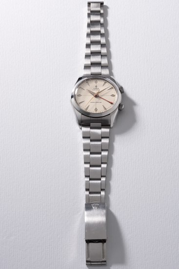 A fine and rare stainless steel wristwatch with sweep center seconds, alarm and bracelet