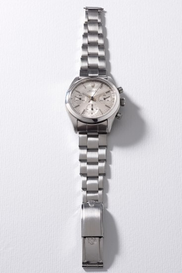 A rare and attractive stainless steel chronograph wristwatch with silvered dial, tachymeter scale and bracelet