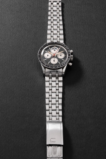 A fine and very rare stainless steel chronograph wristwatch with triple calendar, moon phases, bracelet, guarantee and presentation box