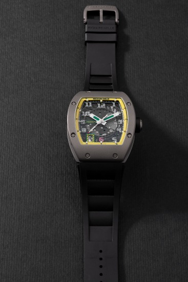 A very fine limited edition titanium tonneau-shaped wristwatch with sweep center seconds, semi-instantaneous date aperture, warranty and box, numbered 89 of a limited edition of 300 pieces