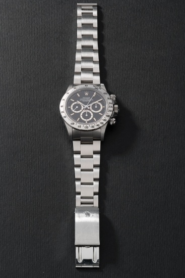 A fine and extremely rare stainless steel chronograph wristwatch with bracelet, guarantee and presentation box
