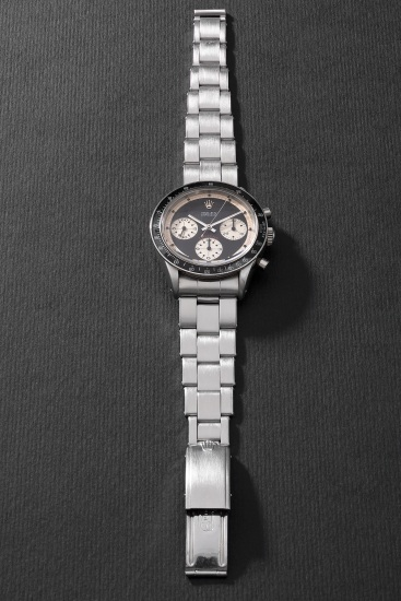 """An iconic, rare and highly attractive stainless steel chronograph wristwatch with black """"Paul Newman"""" dial and bracelet"""