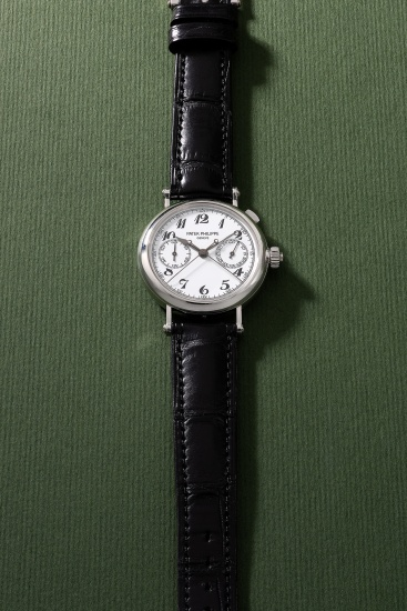 A very rare and highly attractive platinum split seconds chronograph wristwatch with Breguet numerals, white lacquered dial, certificate of origin, additional straps and box