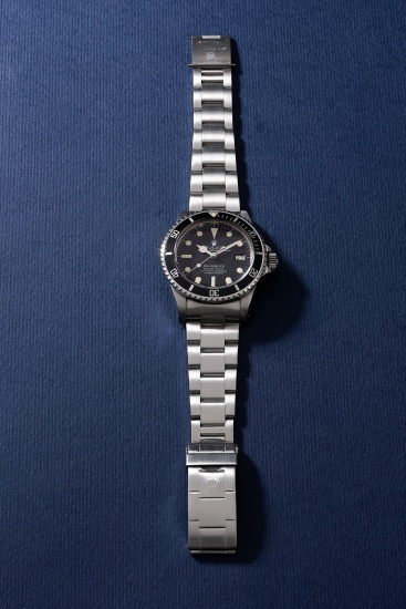 "An attractive and very rare stainless steel diver's wristwatch with ""rail dial"", helium escape valve, date, sweep center seconds, bracelet, guarantee, hang tags and box"