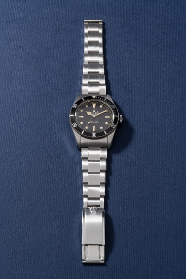 "An extremely attractive and rare stainless steel wristwatch with center seconds, no crown guards, ""exclamation mark"" black glossy dial and bracelet"
