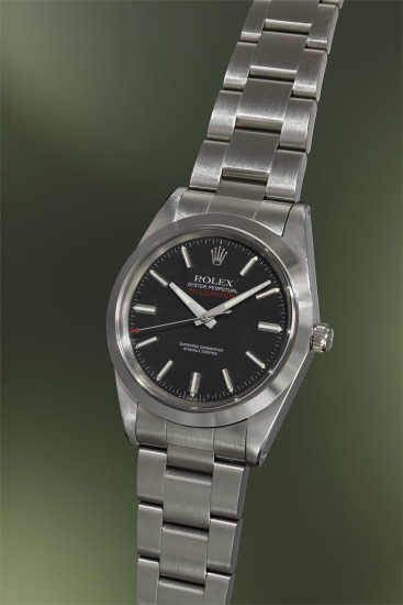 An attractive and rare stainless steel anti-magnetic wristwatch with sweep center seconds, black dial, bracelet, guarantee and presentation box
