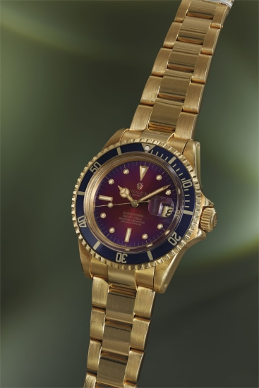 A very rare, attractive and unusual yellow gold wristwatch with sweep center seconds, date, purple 'tropical' 'nipple' dial and bracelet