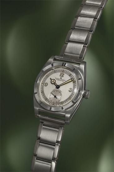 A highly rare and extremely attractive stainless steel wristwatch with two-tone dial and bracelet