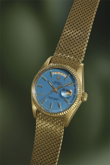 A very rare yellow gold calendar wristwatch with center seconds, turquoise lacquer 'Stella' dial, mesh bracelet, guarantee and presentation box