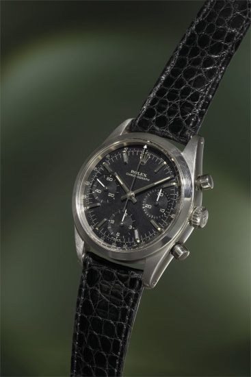 A very rare and highly attractive stainless steel chronograph wristwatch with matte black dial and ivory graphics