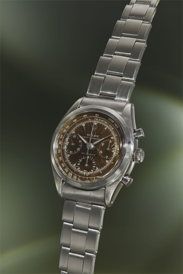 An incredibly rare and attractive stainless steel chronograph wristwatch with black lacquer 'tropical' dial and bracelet