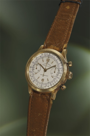 An incredibly rare, exceptionally attractive and very early pink gold chronograph wristwatch with fitted presentation box