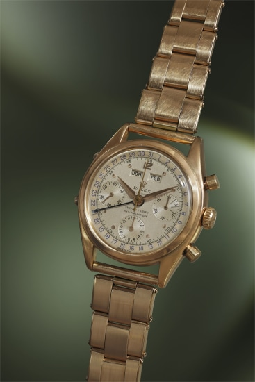 A highly exceptional pink gold Spanish triple calendar chronograph wristwatch with two-tone dial, bracelet and guarantee, retailed by Serpico Y Laino