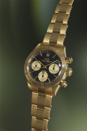 A very rare yellow gold chronograph wristwatch with bracelet, original guarantee, sales tags and fitted presentation box