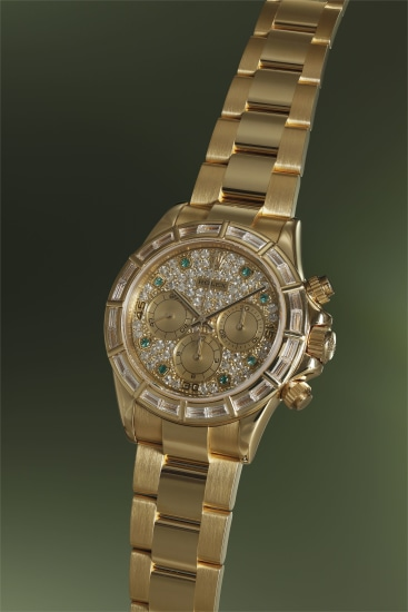 A very rare diamond and emerald-set yellow gold chronograph wristwatch with bracelet, guarantee and fitted presentation box
