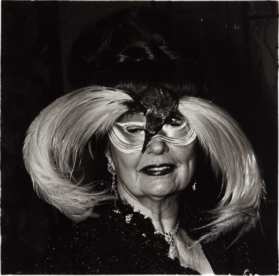 A woman in a bird mask, N.Y.C.
