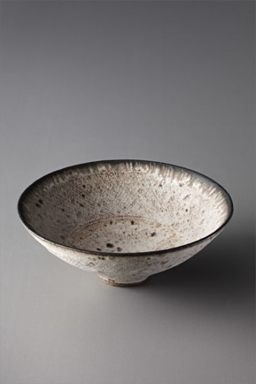 Footed bowl with inlaid design