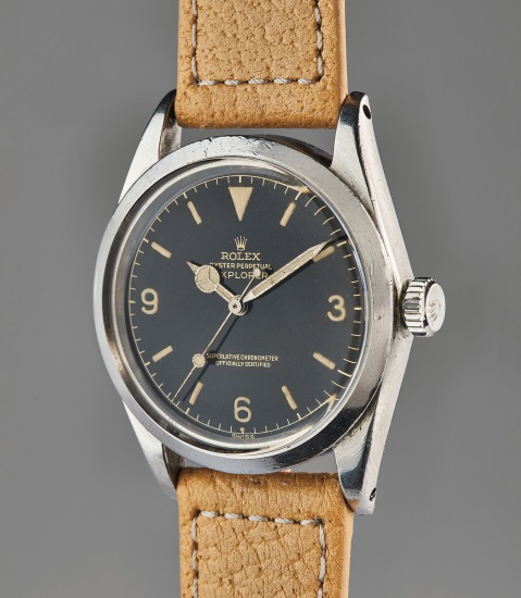 """An early and attractive stainless steel wristwatch with black lacquer """"exclamation"""" dial"""
