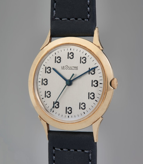 """A unique, historically important, and unusual gold-filled time-only wristwatch with center seconds and """"Lucky 13"""" dial"""