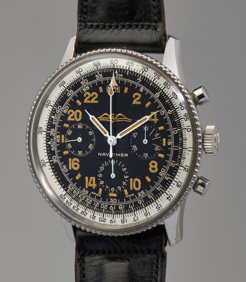 A very rare, extremely well-preserved, and historically important stainless steel chronograph wristwatch with slide rule bezel and 24-hour black gilt dial