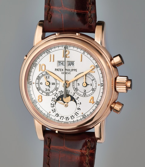 A very fine and rare pink gold perpetual calendar split-seconds chronograph wristwatch with moonphase, Certificate of Origin, additional caseback, and presentation box