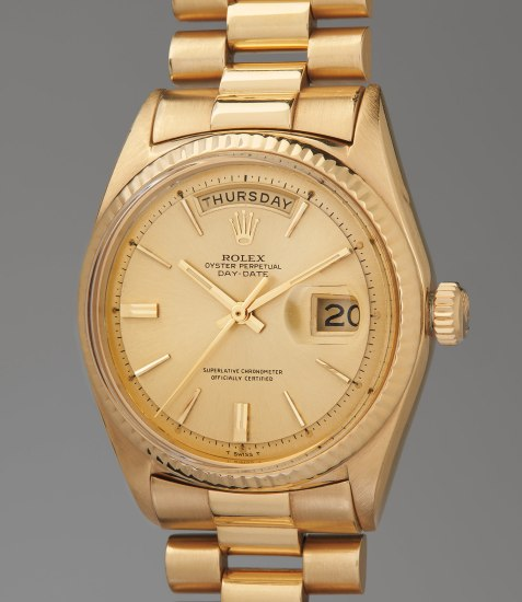 A fine and culturally significant yellow gold wristwatch with day, date and bracelet, sold to benefit the Nicklaus Children's Health Care Foundation