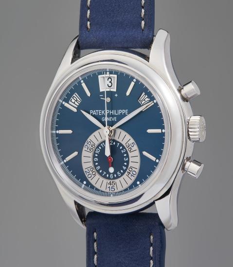 A very fine and rare platinum annual calendar chronograph wristwatch with blue dial, original Certificate of Origin, and presentation box