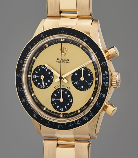 """An extraordinarily rare, extremely attractive, and important yellow gold chronograph wristwatch with """"Paul Newman Lemon"""" dial and service guarantee"""