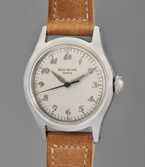 An extremely rare and highly attractive stainless steel wristwatch with center seconds, silvered dial, Breguet numerals, luminous hour markers, and luminous hands